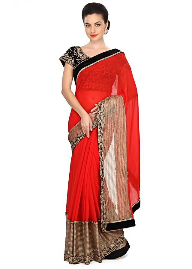 Red saree embellished in fancy lace border only on Kalki