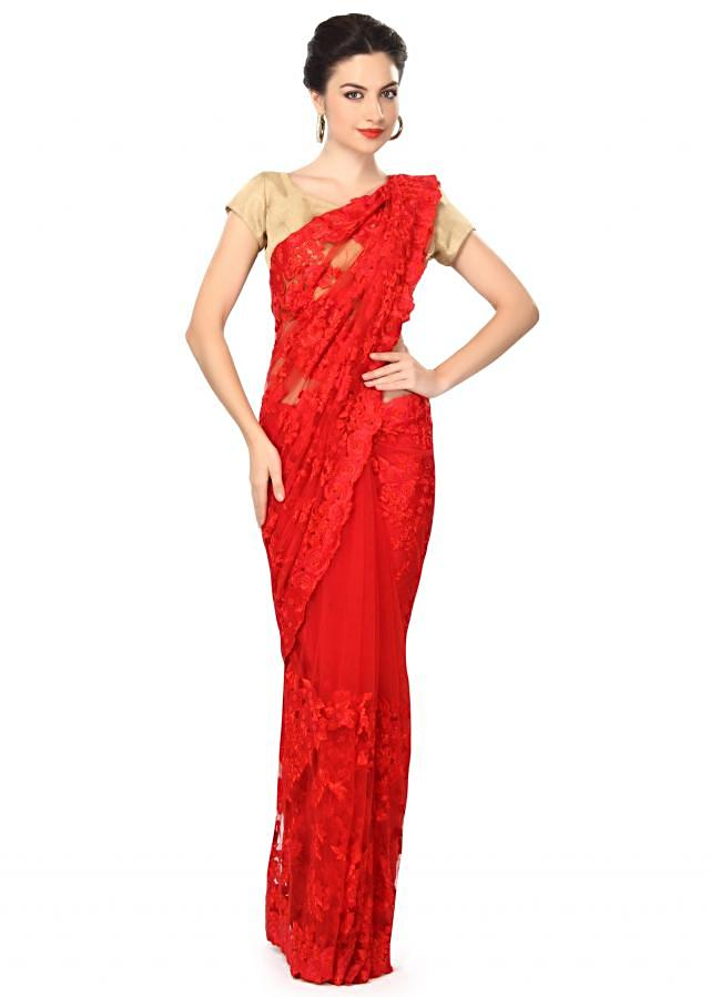 Red saree embellished in resham embroidery in floral motif only on Kalki