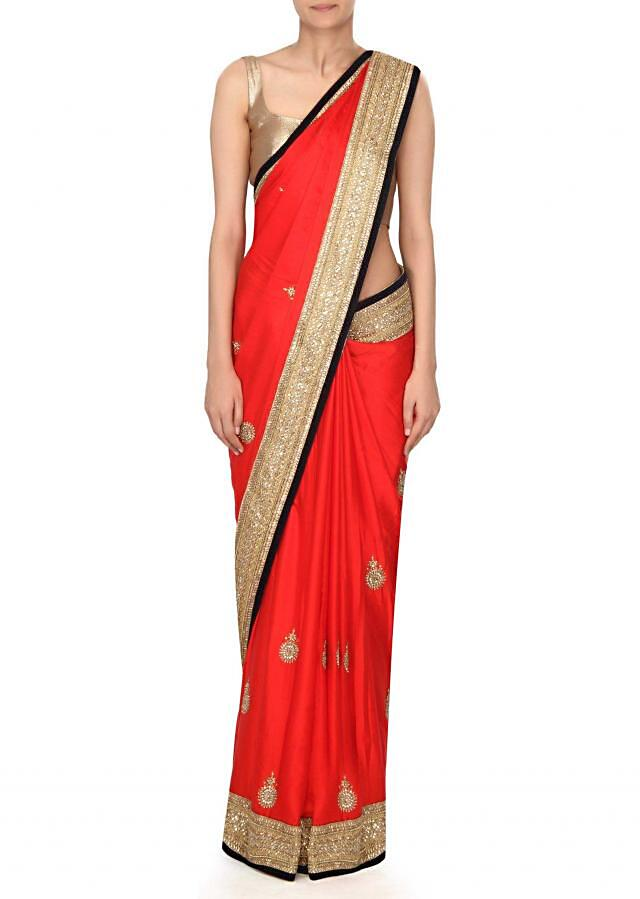 Red saree features in kundan embroidery only on Kalki