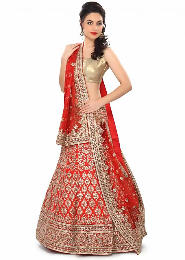 Red semi stitched lehenga embellished in applique and zardosi embroidery only on Kalki