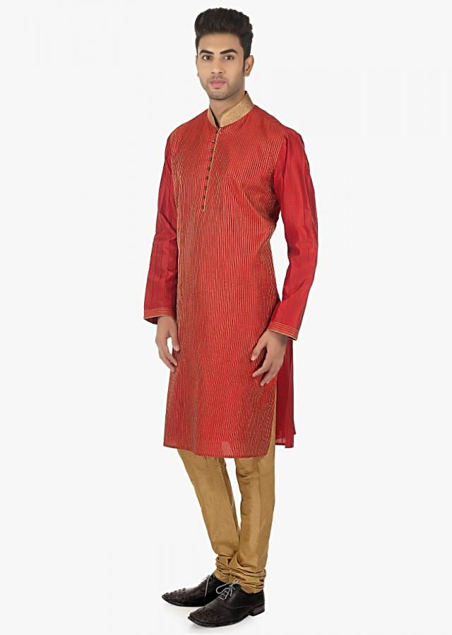 Red solid kurta matched with polyester silk chudidar only on kalki