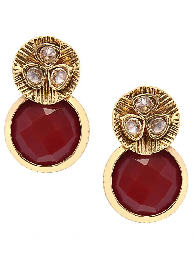 Red stone and kundan embellished earring only on Kalki
