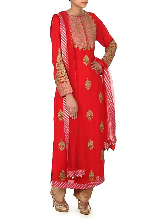 Red straight suit adorn in zari embroidered butti only on Kalki