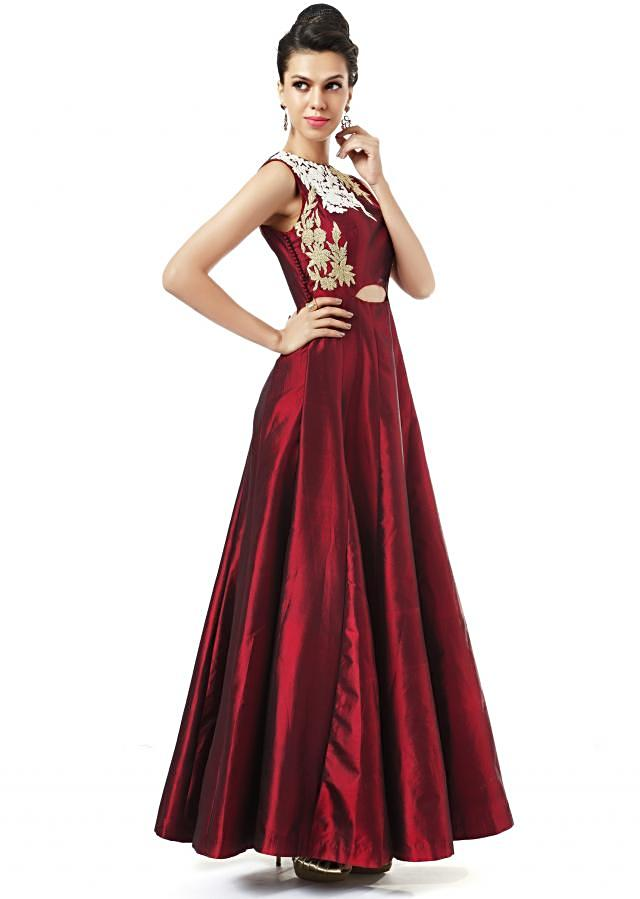 Red suit adorn in zari and thread butti only on Kalki