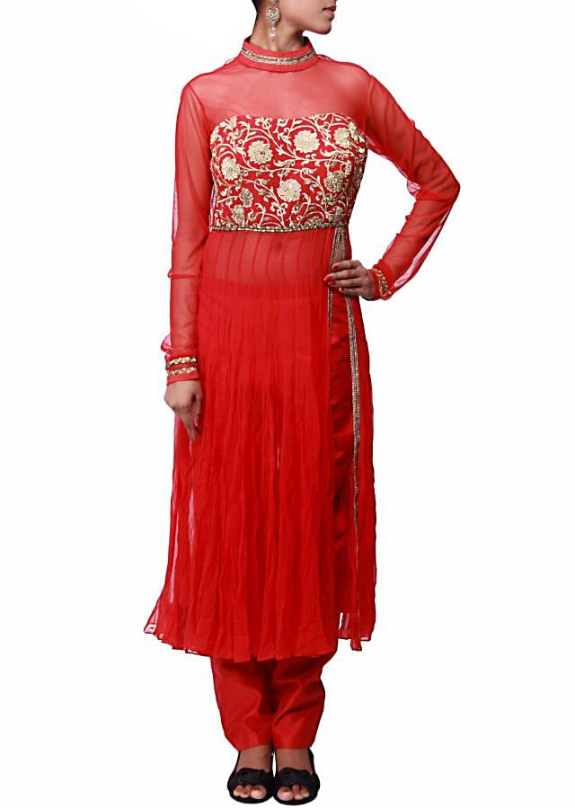 Red suit featuring with zari embroidered bodice only on Kalki