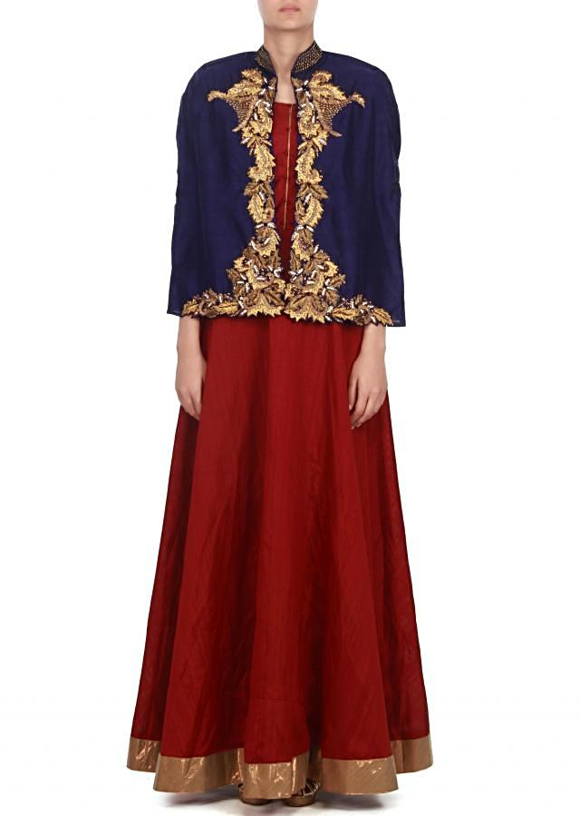 red suit matched with embroidered cape only on kalki