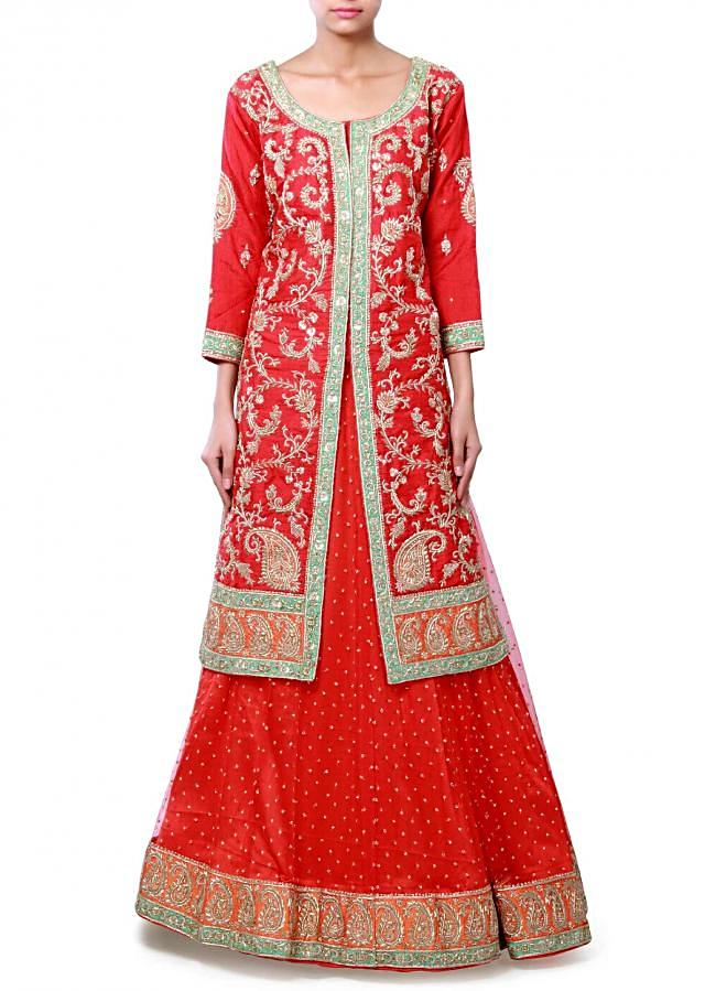Red unstitched lehenga matched with long jacket embroidered blouse only on Kalki