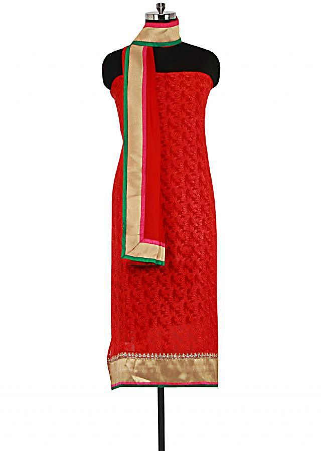 Red unstitched suit adorn in resham embroidery only on Kalki