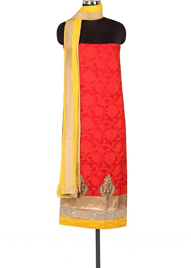 Red unstitched suit enahnced in embroidered hem line only on Kalki