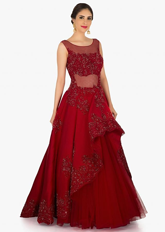 Red gown in net featuring the beautiful cut dana and moti embroidery work only on Kalki