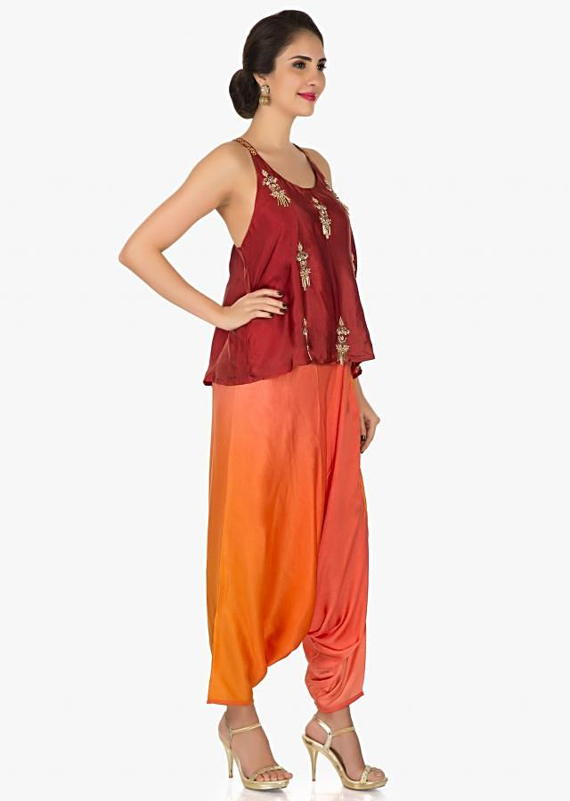 Red satin dhoti suit featuring the zari and sequin embroidery work only on Kalki