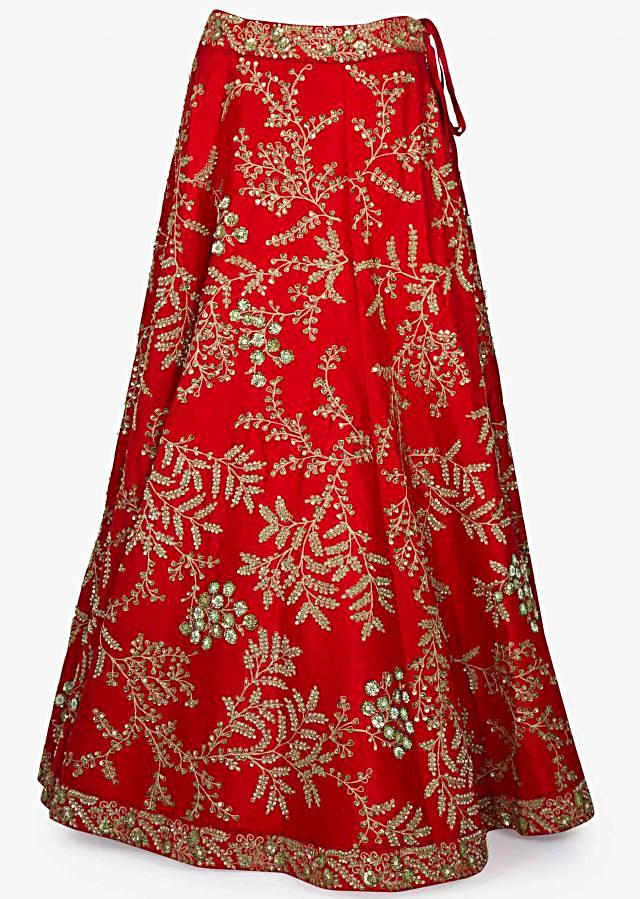 Red Silk Lehenga teamed up with Off White Net dupatta with Kundan and Zari Embellishments Only on Kalki