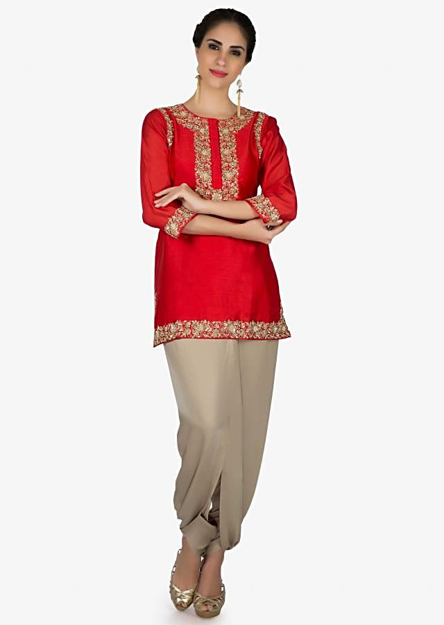 Red suit in embroidered placket matched with dhoti pants only on Kalki
