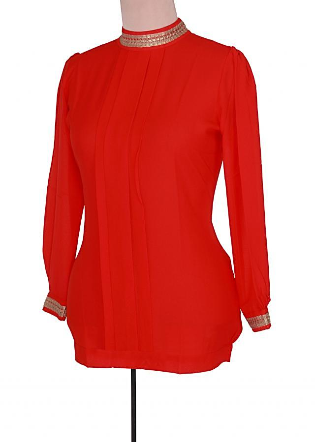 Red tunic features with embroidered collar only on Kalki