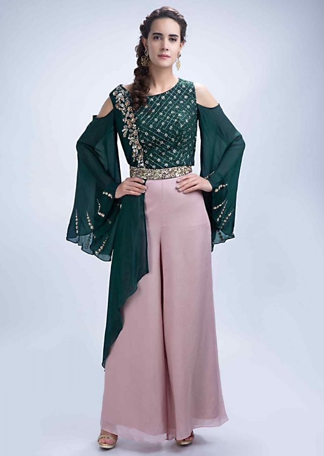 Rose gold palazzo with emerald green fancy cold shoulder crop top with flared sleeves only on Kalki