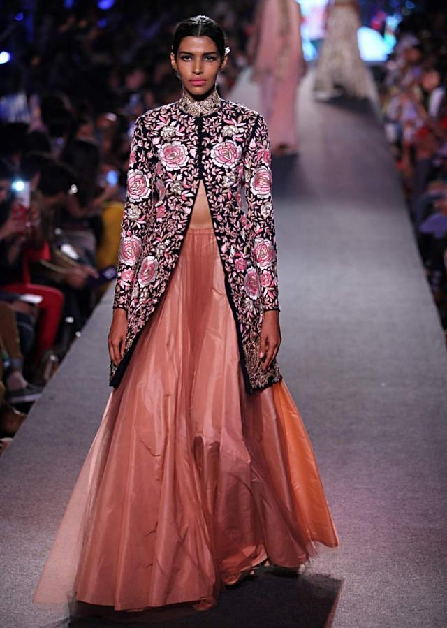 Model walks the ramp in rose motif embroidered jacket matched with lehenga for Manish Malhotra Blue Runway collection at Lakme Fashion Week Summer Resort 2015