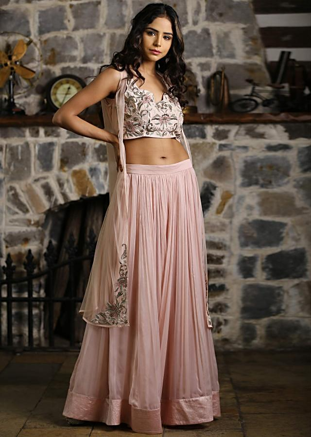 Rose pink crop top paired with peach georgette skirt and matching embroidered jacket only on Kalki