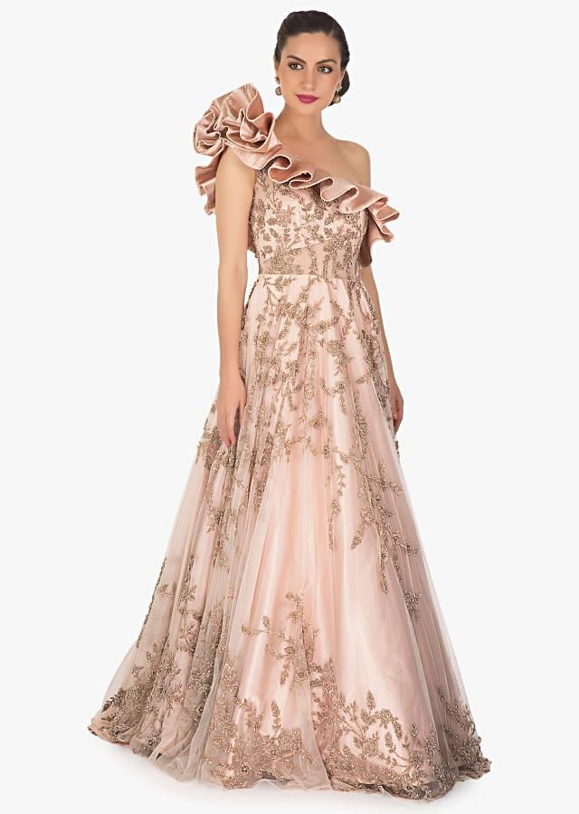 Rose Pink One Shoulder Net and Satin Gown Styled with Ruffles and Handwork Only on Kalki