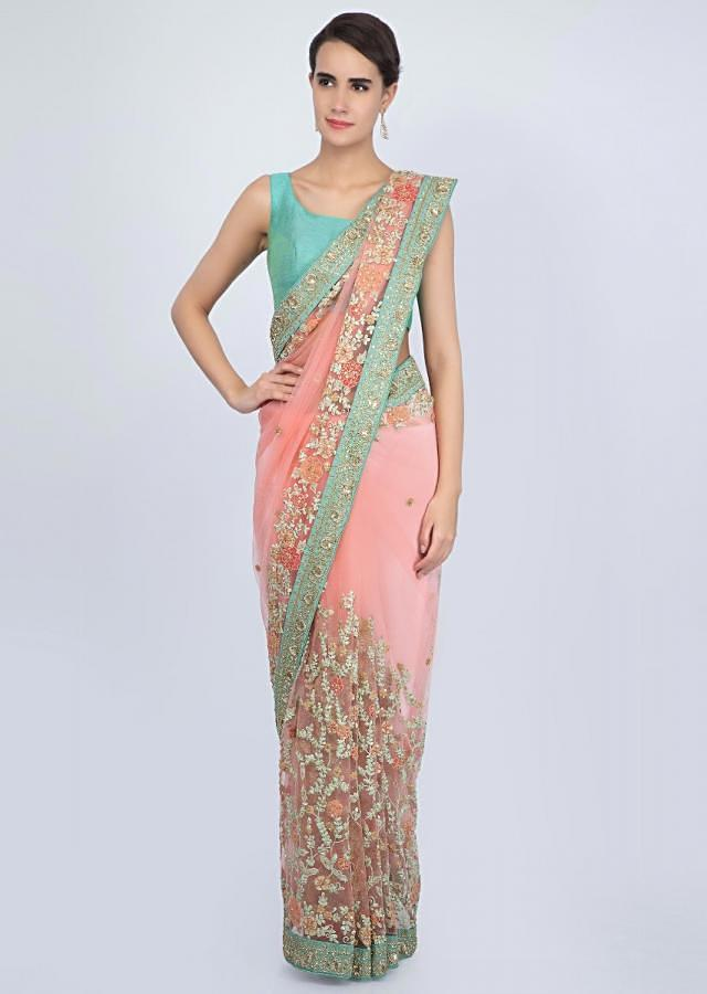 Rouge pink net saree with embroidered jaal work on the lower half and pallo only on Kalki