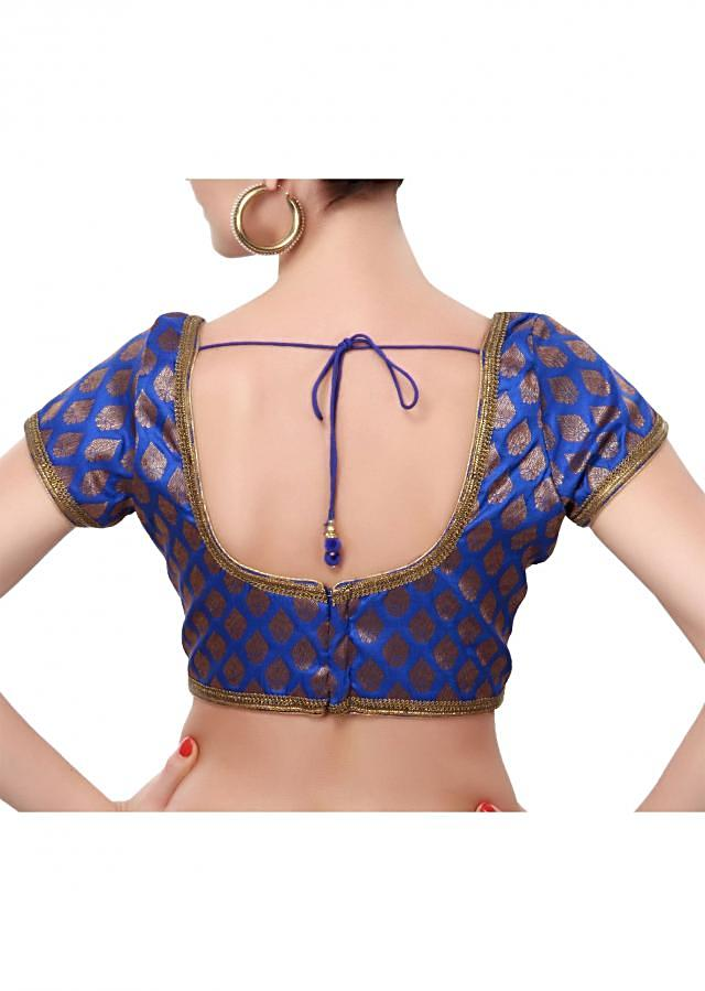 Royal blue blouse adorn in gold lace only on Kalki