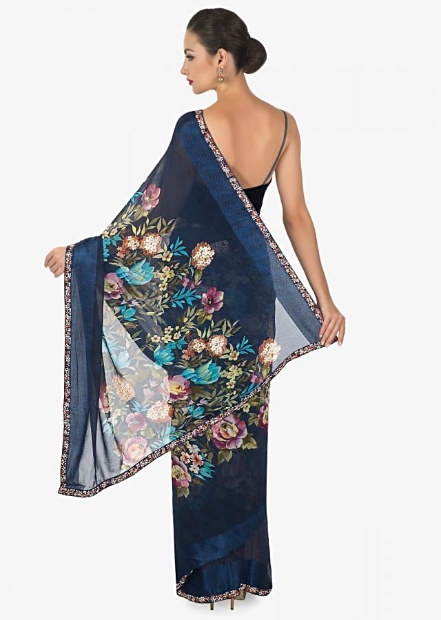 royal blue georgette saree with multi colour floral print and   a rich persion blue silk border