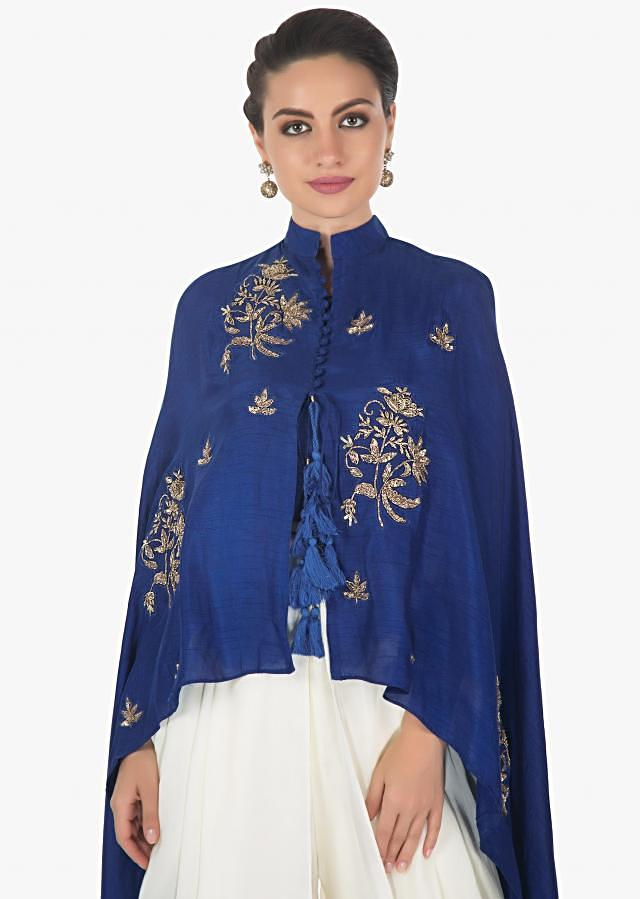 Royal blue raw silk crop top with a cape jacket matched with a fancy dhoti pants only in kalki