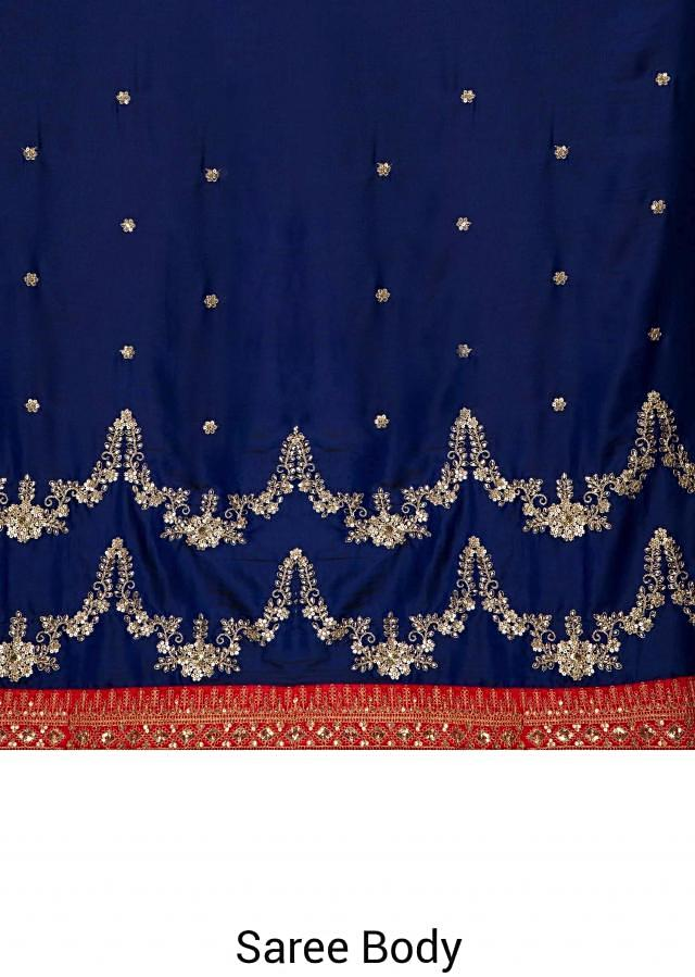 Royal blue satin saree with kundan, zari and sequins only on Kalki