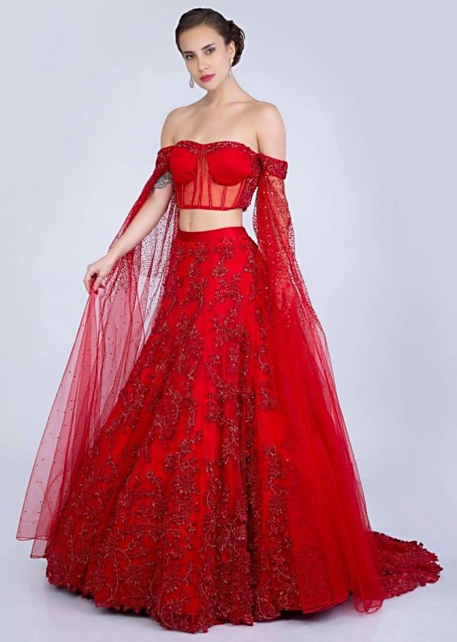 Ruby Red Lehenga In Heavily Embroidered Net With Fancy Off Shoulder Blouse With Long Fared Sleeves Online - Kalki Fashion