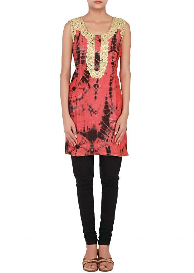 Rust and black kurti with batik print enhanced with gotta patti cut work embroidery only on Kalki