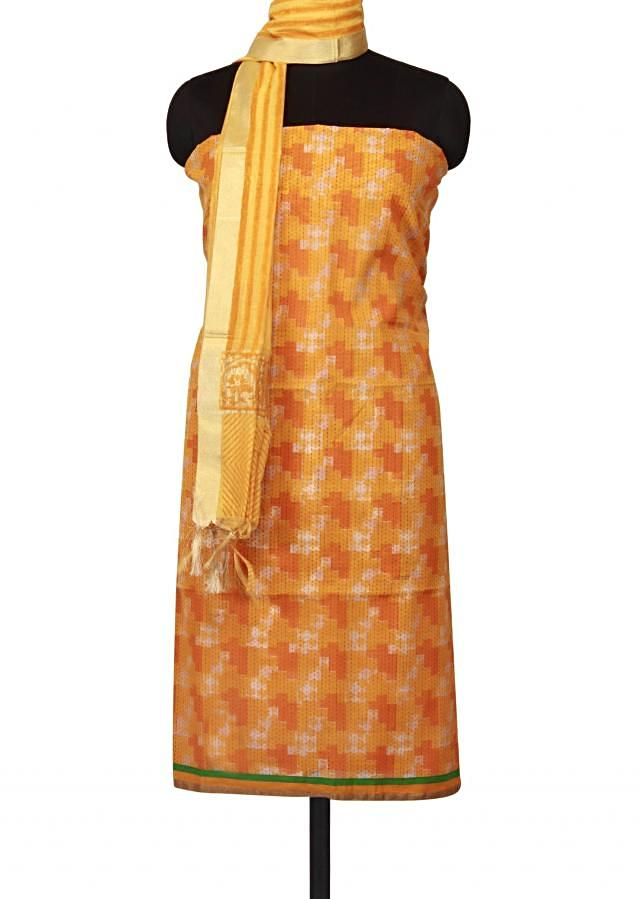 Mustard, orange unstitched suit enhanced in self print only on Kalki
