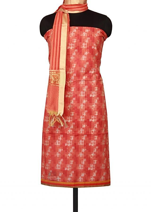 Rust orange unstitched suit enhanced in self print only on Kalki