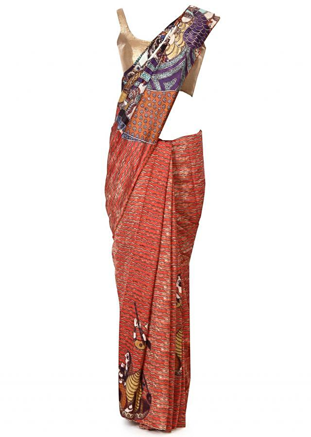 Rust saree features with printed pallav only on Kalki