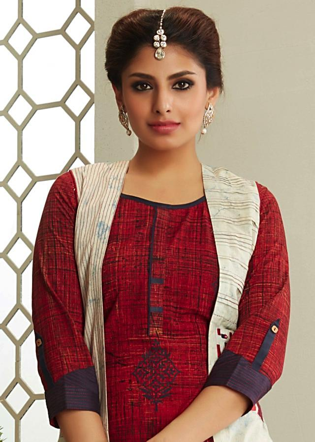 Rust kurti with printed butti matched with cream jacket and navy blue palazzo pant only on Kalki