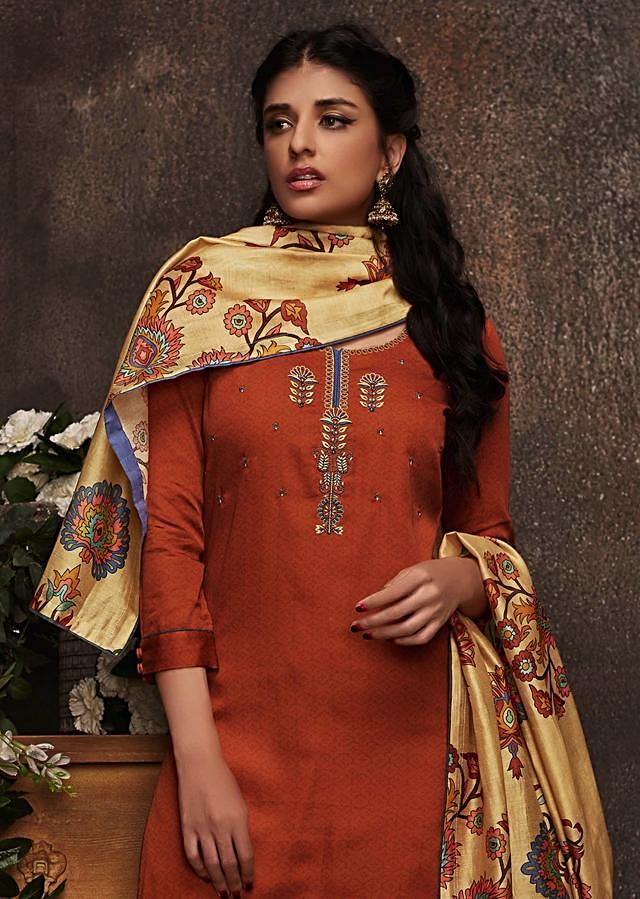Rust unstitched suit in cotton silk with floral motif embroidered placket only on Kalki