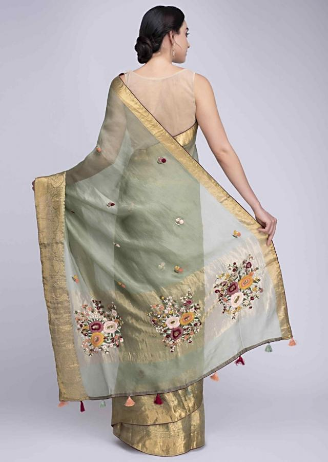 Sage green organza saree with hand embellished floral embroidered butti all over only on Kalki