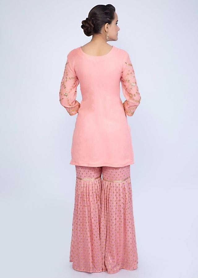 Salmon pink gotta patch embroidered suit with pink weaved sharara only on Kalki