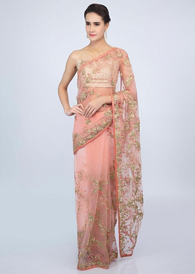 Salmon Pink sheer net saree with embroidered lower bottom and pallo only on kalki