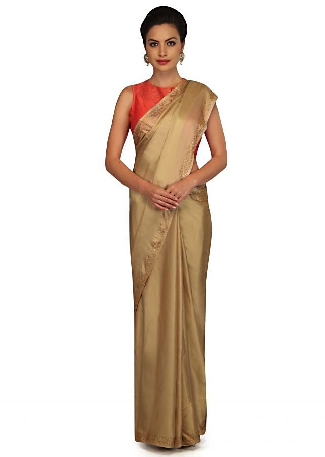 Sand beige saree embellished in gold kundan border only on Kalki