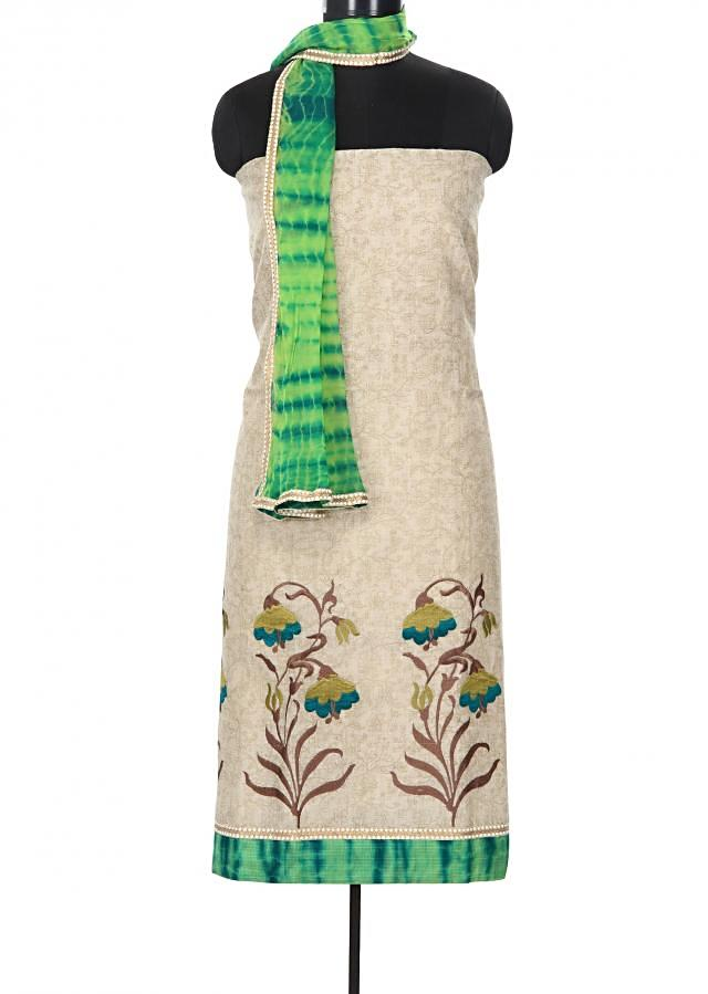 Sand brown unstitched suit enhanced in resham embroidery