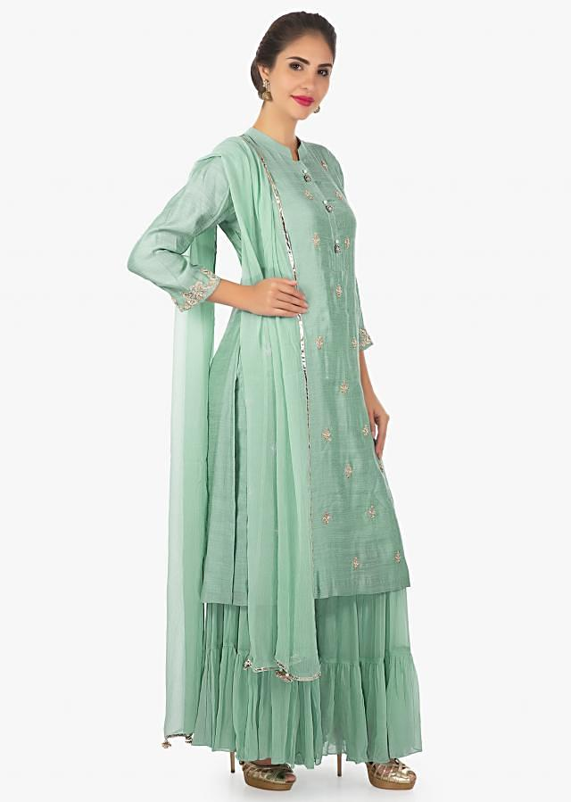 Sapphire blue kurti with zardosi butti and fancy tassel on the placket only on Kalki