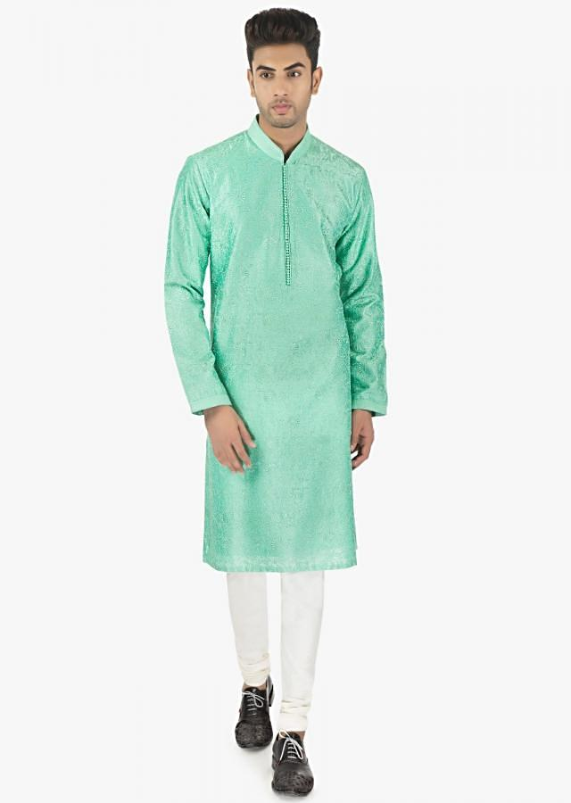 Sapphire silk kurta and White PS silk chudidar set only on kalki
