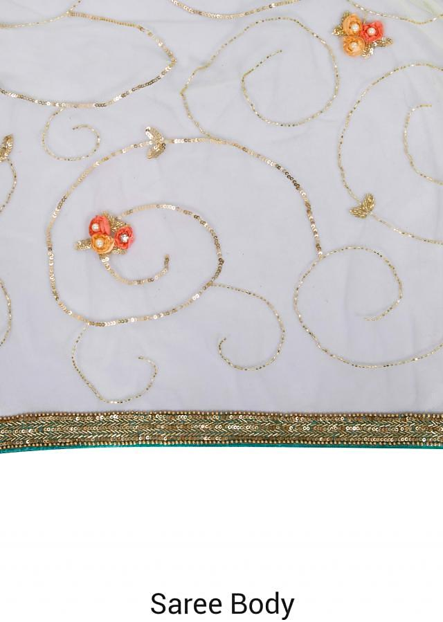 Saree in mint blue with 3D flower embroidery jaal only on Kalki