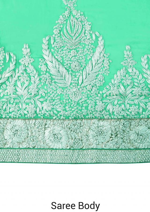 Saree in sea green enhanced in zari and pearl embroidery only on Kalki