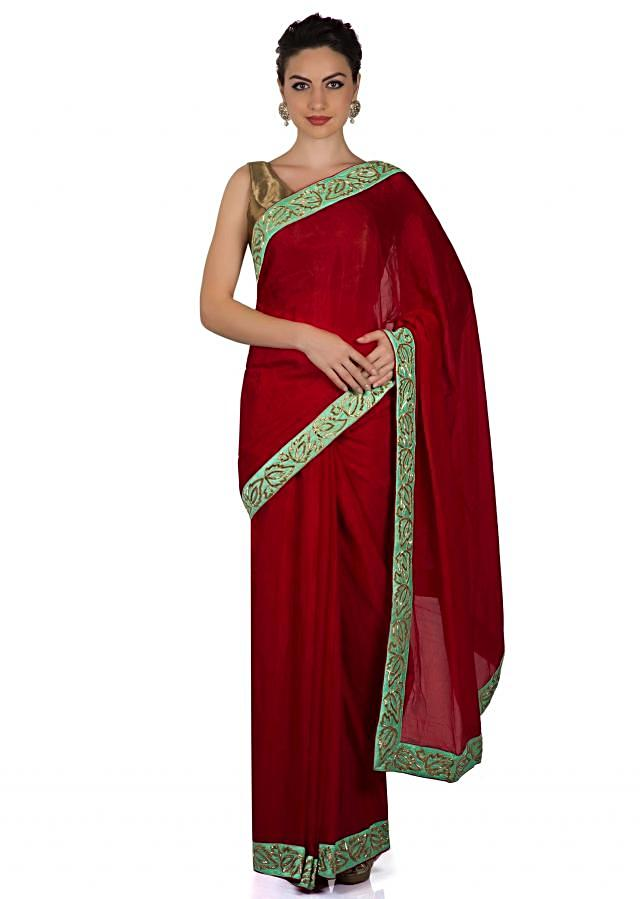 Scarlet red saree with cut dana embroidered border only on Kalki