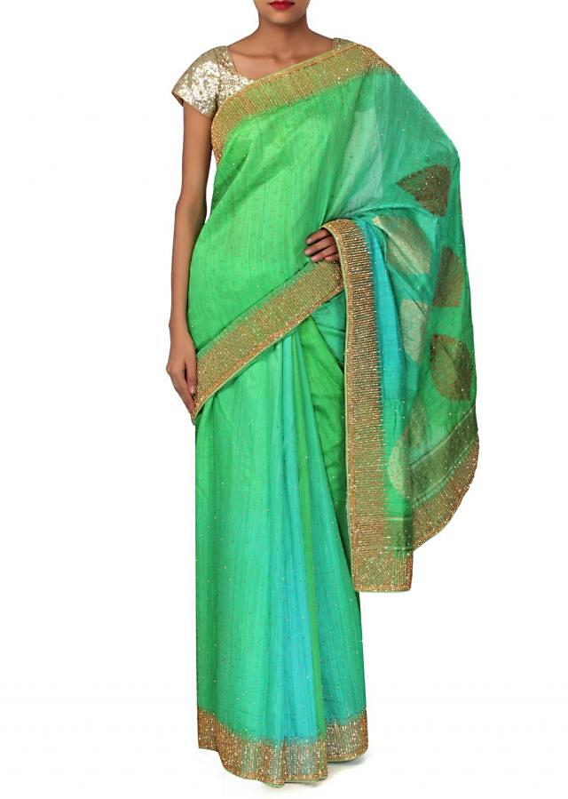 Greenish blue saree adorn in weave and kundan only on Kalki