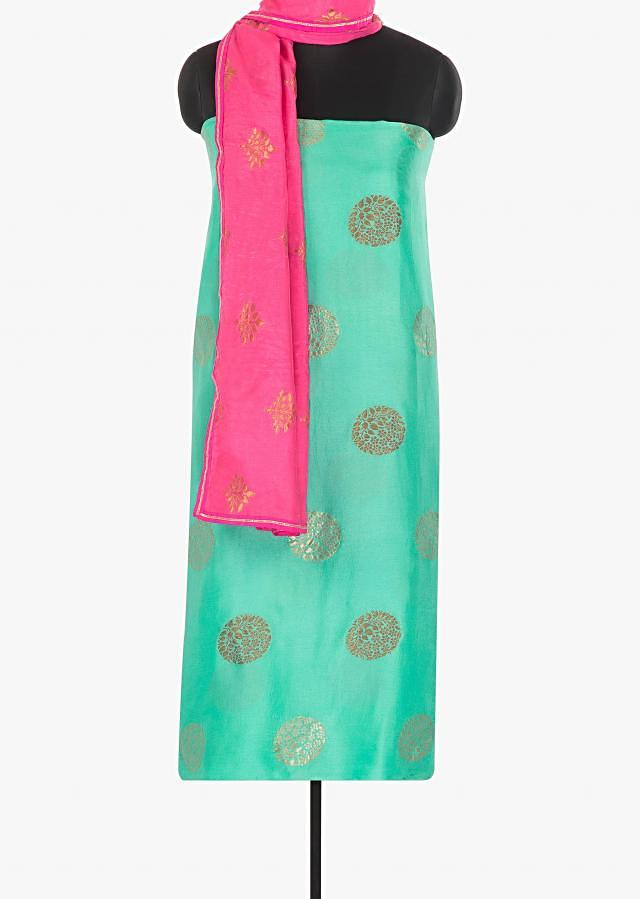 Sea blue santoon unstitched suit in  weaved butti only on Kalki