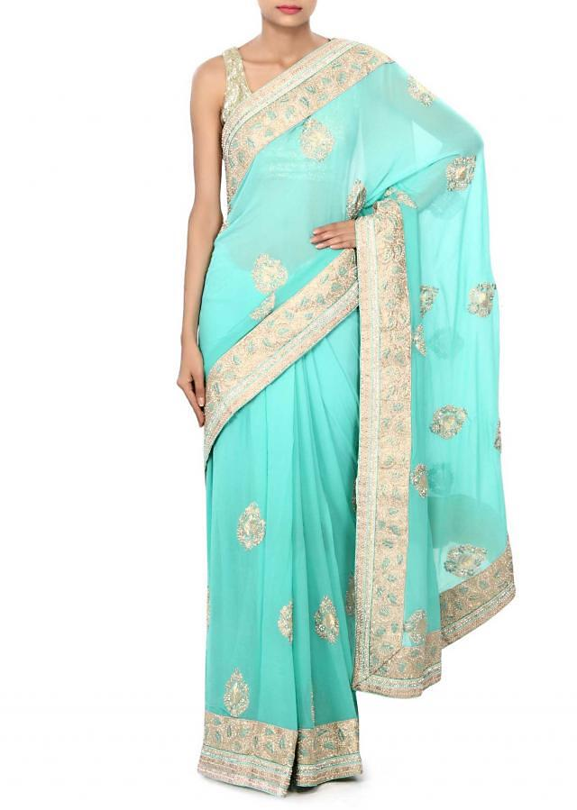 Sea blue saree enhanced in pearl embroidered butti only on Kalki