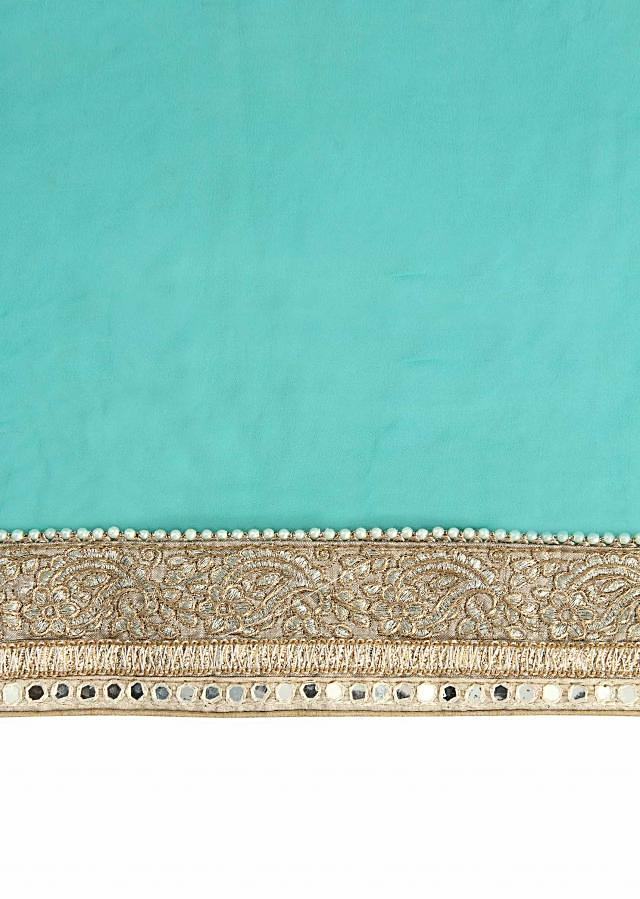 Sea blue saree enhanced in resham embroidery only on Kalki