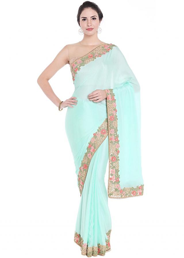 Sea blue saree features in georgette with floral border only on Kalki