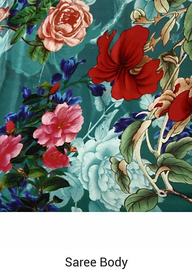 Sea blue saree in floral print only on Kalki
